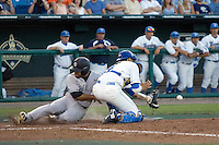 UCLA catcher Steve Rodriguez tries to get the ball as South Carolina's Adrian Morales scores in Game One of the NCAA Division One Men's College World Series Finals on June 28th, 2010 at Johnny Rosenblatt Stadium in Omaha, Nebraska.  (Photo by Andrew Woolley / Four Seam Images)