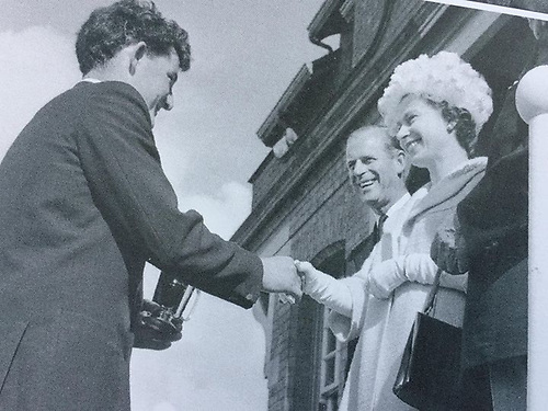 9th August 1961, and Flying Fifteen winner Raymond Gilmore of Kircubbin receives his trophy at RUYC from the Royal couple