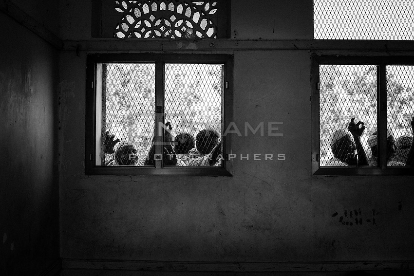 Men waiting at one of the cash distributions that an NGO carries out in the schools of Bayt al-Faqih city.<br /> <br /> The impoverished and heavily populated district of Bayt al-Faqih is one  of the main targets of the international aid nowadays in Yemen.<br /> <br /> October 9th 2012.
