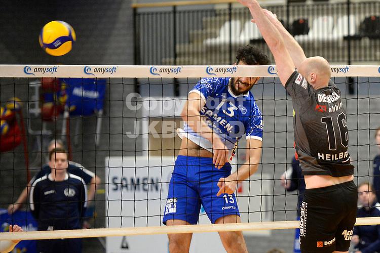 06-03-2021: Volleybal: Amysoft Lycurgus v Active Living Orion: Groningen smash Lycurgus speler Hossein Ghanbari langs Orion speler Jasper Diefenbach