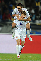 Clint Dempsey of USA celebrates scoring his side's third goal with team-mate Jonathan Spector (21). USA defeated Egypt 3-0 during the FIFA Confederations Cup at Royal Bafokeng Stadium in Rustenberg, South Africa on June 21, 2009.