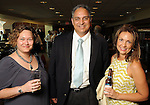 From left: Wendy Burke, Chuck Martinez and Cindy Young at the Texas A&M Energy Institute reception at the West Club in Reliant Stadium Wednesday May 2,2012. (Dave Rossman Photo)