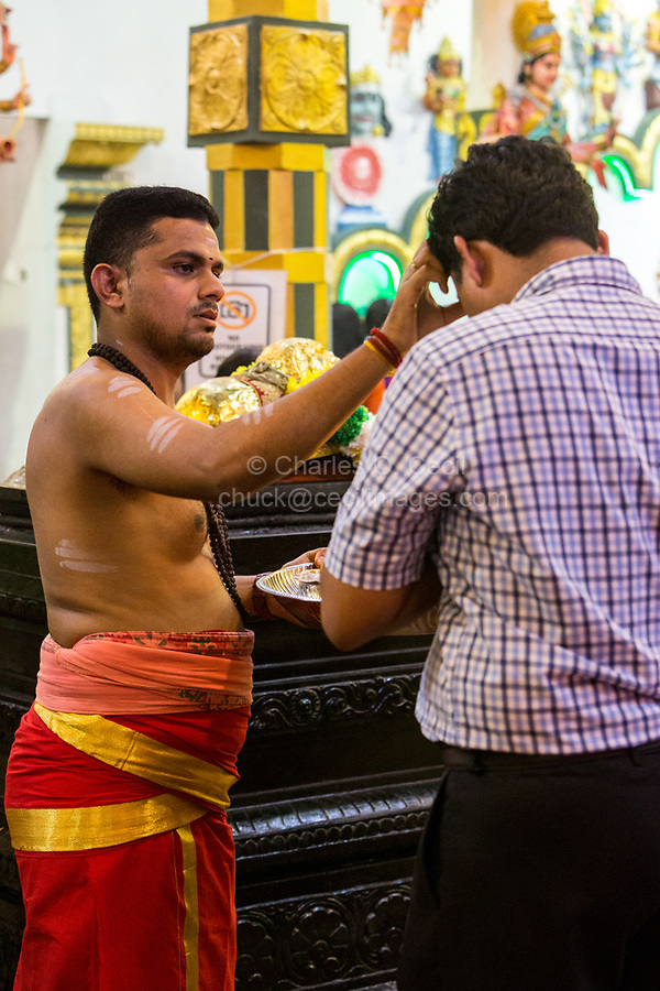 Hindu Temple, Sri Maha Mariamman, Priest Blessing a Worshiper during Navarathri Celebrations, George Town, Penang, Malaysia.