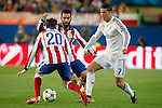 Atletico de Madrid's Juanfran Torres (l) and Arda Turan (c) and Real Madrid's Cristiano Ronaldo during Champions League 2014/2015 Quarter-finals 1st leg match.April 14,2015. (ALTERPHOTOS/Acero)