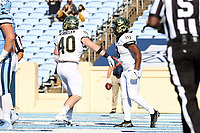 CHAPEL HILL, NC - NOVEMBER 14: Kenneth Walker III #9 of Wake Forest celebrates his touchdown with Connor Hebbeler #40 during a game between Wake Forest and North Carolina at Kenan Memorial Stadium on November 14, 2020 in Chapel Hill, North Carolina.