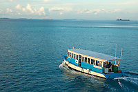 Dhoni boat cruising at sunset, Maldives.