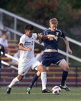 Boston College defender/forward Kevin Mejia (12) dribbles as Quinnipiac University forward Nils von der Heide (7) defends. Boston College defeated Quinnipiac, 5-0, at Newton Soccer Field, September 1, 2011.