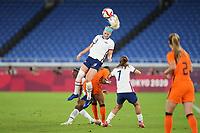 YOKOHAMA, JAPAN - JULY 30: Julie Ertz #8 of the United States heads the ball during a game between Netherlands and USWNT at International Stadium Yokohama on July 30, 2021 in Yokohama, Japan.