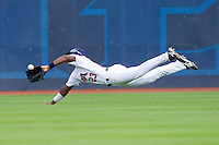 Center fielder Jackie Bradley Jr. #23 of Team USA makes a diving catch against Team Korea at Durham Bulls Athletic Park July 18, 2010, in Durham, North Carolina.  Photo by Brian Westerholt / Four Seam Images