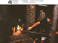 Dogs are beaten to death below a restaurant in Hanoi. Dogs meat is considered a delicacy in Vietnam with increasing numbers being illegally stolen and shipped across the border from Thailand.
