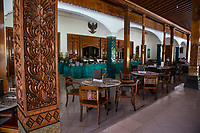 Yogyakarta, Java, Indonesia.  Ndalem Ngabean Restaurant Offering a Buffet Lunch.  Pillar with Carved Lotus Flower on Left.