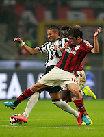 Calcio, Serie A: Milan vs Juventus, Milano, stadio San Siro, 20 settembre 2014.<br /> From left. Juventus midfielder Roberto Pereyra, of Argentina, and AC Milan midfielders Sulley Ali Muntari, of Ghana, and Andrea Poli fight for the ball during the Italian Serie A football match between AC Milan and Juventus at Milan's San Siro stadium, 20 September 2014.<br /> UPDATE IMAGES PRESS/Isabella Bonotto
