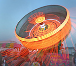 """A """"zero gravity"""" ride spinning during the Mill Valley Memorial Day Carnival."""