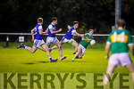John Mitchels Alan O'Donoghue goal bound and tackled by   the Kerins O'Rahillys defence in the Tralee Town Board SFC semi-final.