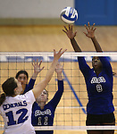 Marymount's Morgan McAlpin blocks during a college volleyball match at Washington & Lee University Lexington, Vir., on Saturday, Oct. 5, 2013.<br /> Photo by Cathleen Allison