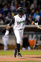 Dayton Dragons outfielder Junior Arias #24 hits a home run during a game against the Bowling Green Hot Rods on April 20, 2013 at Fifth Third Field in Dayton, Ohio.  Dayton defeated Bowling Green 6-3.  (Mike Janes/Four Seam Images)