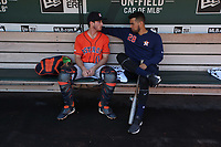 OAKLAND, CA - JUNE 2:  Garrett Stubbs #11 and Robinson Chirinos #28 of the Houston Astros talk in the dugout before the game against the Oakland Athletics at the Oakland Coliseum on Sunday, June 2, 2019 in Oakland, California. (Photo by Brad Mangin)