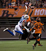 Vancouver, September, 09, 2016 - Duron Carter [L] reaches for the ball. The Montreal Alouettes lost to the BC Lions 27-38. (Andrew Soong)