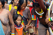 Altamira, Brazil. Kayapo Indian family - mother, father and son.