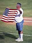 A fan holds up the American flag during the American Association of Independant Professional Baseball game between the Amarillo Sox and the Fort Worth Cats at the historic LaGrave Baseball Field in Fort Worth, Tx. Fort Worth defeats Amarillo 3 to 0......