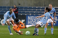Sky Blue FC forward Natasha Kai (6) getts tripped up between Chicago Red Stars midfielders Carli Lloyd (10, left) and Brittany Klein (6, right).  The Chicago Red Stars tied Sky Blue FC 0-0 at Toyota Park in Bridgeview, IL on April 19, 2009.