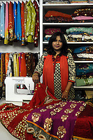 "Laila Shah, titolare del negozio ""Laila fashion "", abbigliamento bangladese e indiano e accessori.Quartiere di Torpignattara. VI Municipio, circa 48.000 abitanti.In questo quartiere convivono numerose comunità di immigrati..Laila Shah, owner of the shop ""Laila fashion"", Bangladeshi and Indian clothing and accessories.Torpignattara district. VI Hall, about 48,000 inhabitant.In this district live many immigrant communities..."