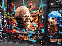 Fresh Nelson Mandela portrait on wall in Spuistraat after his death on 5 December 2013.<br /> <br /> Photo Kees Metselaar