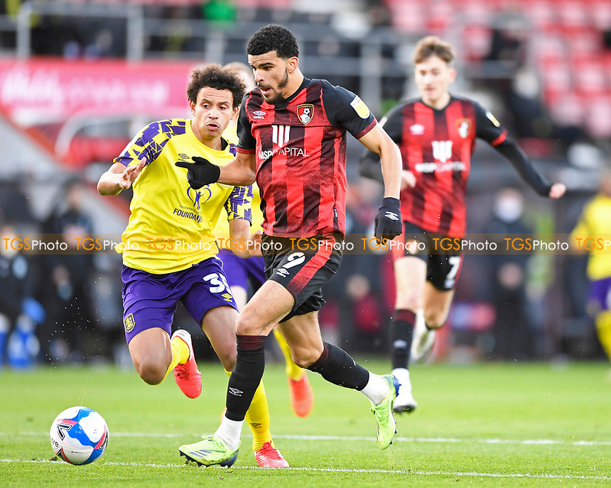 Dominic Solanke of AFC Bournemouth goes past Rarmani Edmonds-Green of Huddersfield Town before scoring the first goal during AFC Bournemouth vs Huddersfield Town, Sky Bet EFL Championship Football at the Vitality Stadium on 12th December 2020
