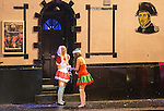"""© Joel Goodman - 07973 332324 . NO SYNDICATION PERMITTED . 20/12/2014 . Manchester , UK . Two women dressed in seasonal costumes outside Napoleons pub on Bloom Street . """" Mad Friday """" revellers out in the rain and cold in Manchester . Mad Friday is typically the busiest day of the year for emergency services , taking place on the last Friday before Christmas when office Christmas parties and Christmas revellers enjoy a night out .  Photo credit : Joel Goodman"""