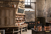 The old Tudor kitchen features a collection of copper pots and pans