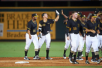 Bradenton Marauders Kevin Kramer (14) high fives teammates after a walk off base hit during a game against the Palm Beach Cardinals on August 8, 2016 at McKechnie Field in Bradenton, Florida.  Bradenton defeated Palm Beach 5-4.  Jose Regalado (51) also shown.  (Mike Janes/Four Seam Images)