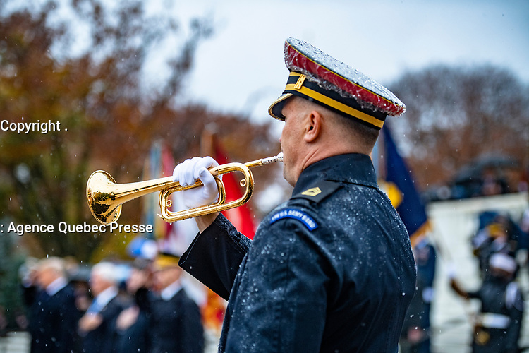 """A bugler from The U.S. Army Band, """"Pershing's Own"""" participates in a Presidential Armed Forces Full Honor Wreath-Laying Ceremony at the Tomb of the Unknown Soldier; Arlington National Cemetery, Arlington, Virginia, November 11, 2020. The wreath was laid by President Donald J. Trump as part of the nation's 67th Veterans Day Observance. (U.S. Army photo by Elizabeth Fraser / Arlington National Cemetery / released)"""