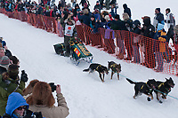 Jeff King team leaves the start line during the restart day of Iditarod 2009 in Willow, Alaska