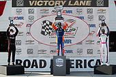 #9: Scott Dixon, Chip Ganassi Racing Honda, #12: Will Power, Team Penske Chevrolet, #55: Alex Palou,  Dale Coyne Racing with Team Goh Honda celebrate on the podium