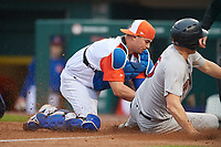 "Buffalo Bisons catcher Reese McGuire (7) tags Ryan McBroom (6) out at home during an International League game against the Scranton/Wilkes-Barre RailRiders on June 5, 2019 at Sahlen Field in Buffalo, New York.  The Bisons wore special uniforms as they played under the name the ""Buffalo Wings"". Scranton defeated Buffalo 3-0, the first game of a doubleheader. (Mike Janes/Four Seam Images)"