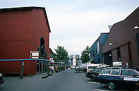 Vancouver: Granville Island--Original industrial (Boatworks) structure left. New buildings on right. Photo '86.