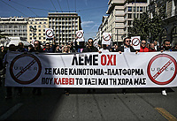 "Pictured: Taxi drivers holding ""Uber, No Thanks"" and with a banner which reads ""We Say No"" protest in Syntagma Square, Athens Greece. Tuesday 06 March 2018<br /> Re: Taxi drivers have attacked Uber vehicles while protesting against Uber operating in Athens, Greece.<br /> Taxi drivers will on strike for nine hours on Tuesday8 a.m. to 5 p.m. in protest at what they call unfair competition from Uber taxi services.<br /> In a statement, the SATA union representing cab drivers in Attica also expressed dismay at delays in passing a Transport Ministry bill to reorganize their sector and derided ""innovative platforms that rob taxi drivers and the country."""
