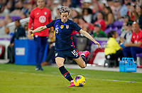 ORLANDO, FL - MARCH 05: Megan Rapinoe #15 of the United States passes off the ball during a game between England and USWNT at Exploria Stadium on March 05, 2020 in Orlando, Florida.