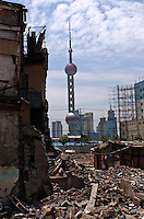 Old houses are demolished in front of the modern Shanghai, China..30 Jun 2005