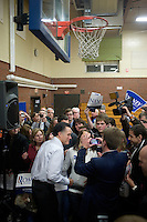 Former Massachusetts governor Mitt Romney greets the public and signs autographs in the overflow area in a gymnasium at a Romney town hall campaign event at McKelvie Intermediate School in Bedford, New Hampshire, on Jan. 9, 2012.  Romney is seeking the 2012 Republican presidential nomination.