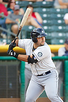 Jesus Montero (20) of the Tacoma Rainiers at bat against the Salt Lake Bees in Pacific Coast League action at Smith's Ballpark on July 8, 2014 in Salt Lake City, Utah.  (Stephen Smith/Four Seam Images)