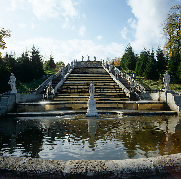 View looking up the Golden Hill Cascade over the central fountain in the grounds of Peterhof Palace outside St Petersburg