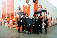 KEXP portraits at mural by Painter Jonathan Wakuda Fischer