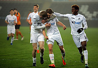 Pictured: George Byers of Swansea City (C) celebrates his goal with co-scorer Oliver McBurnie (L) and Jordan Garrick Monday 13 March 2017<br />Re: Premier League 2, Swansea City U23 v Wolverhampton Wanderers FC at the Liberty Stadium, Swansea, UK