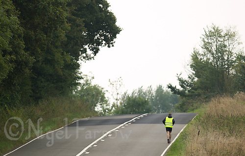 29 SEP 2013 - SANDLING, GBR - Andy Moore runs along a country road near Sandling, Kent, Great Britain during the Enduroman 2013 Lands End to London to Dover ultra triathlon (PHOTO COPYRIGHT © 2013 NIGEL FARROW, ALL RIGHTS RESERVED)