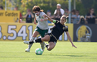 Sarah Walsh (left) fights to hold off Leslie Osborne (left) as Osborne attempts to slide in to steal the ball. FC Gold Pride tied the St. Louis Athletica 1-1 at Buck Shaw Stadium in Santa Clara, California on August 9, 2009.