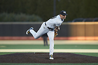 Wake Forest Demon Deacons starting pitcher Ryan Cusick (33) follows through on his delivery against the Louisville Cardinals at David F. Couch Ballpark on March 6, 2020 in  Winston-Salem, North Carolina. The Cardinals defeated the Demon Deacons 4-1. (Brian Westerholt/Four Seam Images)
