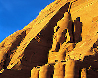 Statue of seated King Rameses II at Abu Simbel on Lake Nasser, southern Egyp