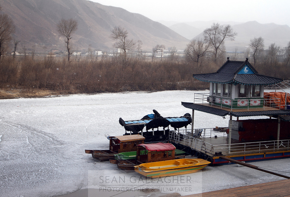 China. Jilin Province. The Tumen River which separates China (near side) and North Korea (far side). Tumen is part of the Korean Autonomous Prefecture in the north-east of the country. 2011
