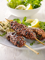 Kofta kebabs with salad.